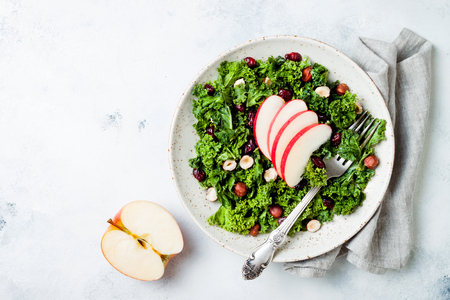 Kale salad with dried cranberry, hazelnuts and sliced apple