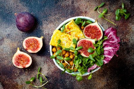Vegan, detox Buddha bowl recipe with turmeric roasted tofu, figs, chickpeas and greens. Top view, flat lay Archivio Fotografico - 108251533