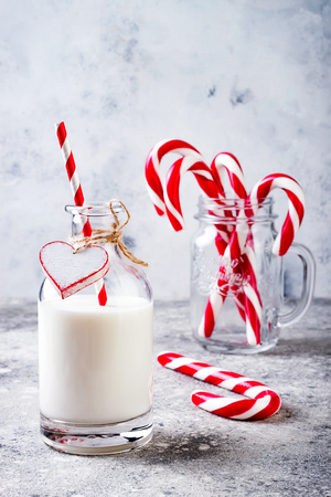 Christmas milk for Santa in bottle with straw and peppermint candy cane. Christmas holiday party drink idea 版權商用圖片