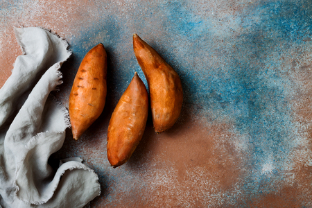 Sweet potato on rustic table. Cooking concept. Top view Standard-Bild