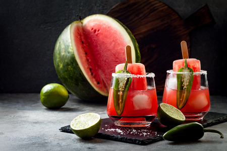 Spicy watermelon ice cream margarita cocktail with jalapeno and lime. Mexican alcoholic drink for Cinco de mayo party