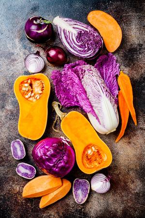 Seasonal winter autumn fall vegetables on rustic background. Plant based vegan or vegetarian cooking concept. Clean eating food, alkaline diet