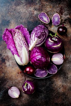 Seasonal winter autumn purple vegetables background. Plant based vegan or vegetarian cooking concept. Clean eating food, alkaline diet