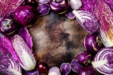 Seasonal winter autumn purple vegetables copy space background. Plant based vegan or vegetarian cooking concept. Clean eating food, alkaline diet Zdjęcie Seryjne