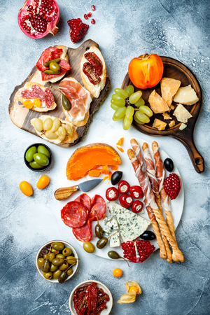 Appetizers table with antipasti snacks. Stock Photo
