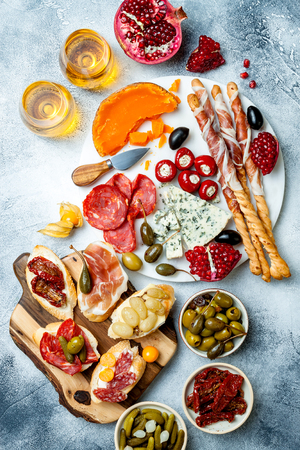 Appetizers table with antipasti snacks and wine in glasses. Stok Fotoğraf