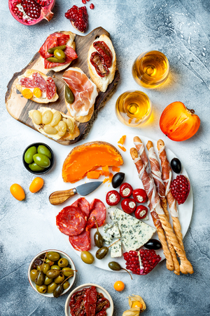 Appetizers table with antipasti snacks and wine in glasses. Stock Photo
