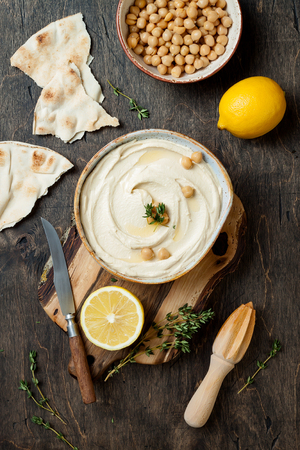 Homemade hummus with thyme, olive oil. Middle Eastern traditional and authentic arab cuisine. Top view, flat lay, overhead Stock Photo