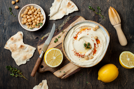 Homemade hummus with paprika, thyme, olive oil. Middle Eastern traditional and authentic arab cuisine. Stock Photo