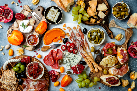 Appetizers table with antipasti snacks. Bruschetta or authentic traditional spanish tapas set