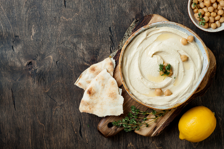 Homemade hummus with thyme, olive oil.