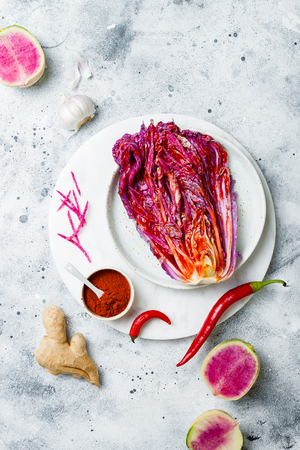 Cabbage kimchi, top view. Preparing purple cabbage and watermelon radish kimchi.