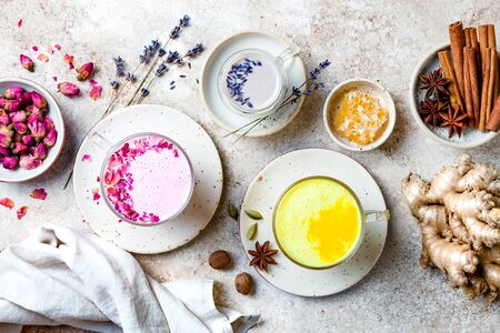 Variety of Moon Milk for a better sleep. Turmeric golden milk, pink rose milk and lavender moon milk. Trendy relaxing bedtime drink Banque d'images
