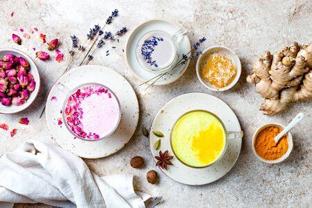 Variety of Moon Milk for a better sleep. Turmeric golden milk, pink rose milk and lavender moon milk. Trendy relaxing bedtime drink Stock Photo
