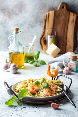 Italian pasta spaghetti with grilled shrimps, pesto sauce and fresh basil leaves Stock fotó