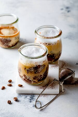 Healthy cappuccino, coffee latte chia pudding with milk foam in a glass jar. Vegan healthy breakfast, clean eating.