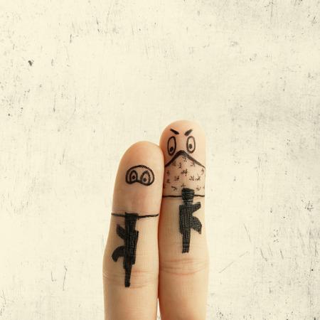 terrorists: Toned image  metaphor drawn on fingers terrorists with guns Stock Photo