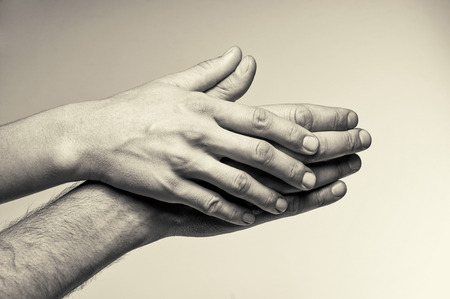 tenderness: Two hands attention and tenderness