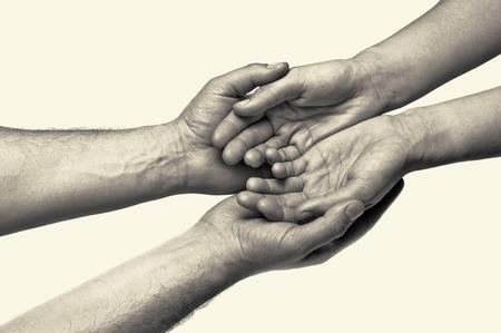 honestidad: Dos manos (confianza entre los dos) Foto de archivo