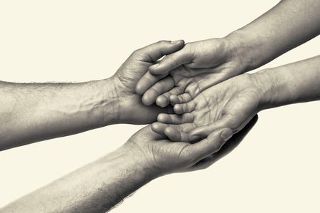 strength in unity: Two hands (trust between the two) Stock Photo
