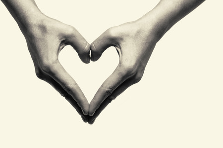 Two hands portraying heart