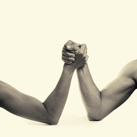 rivalry: two hands depicting the rivalry of men and women