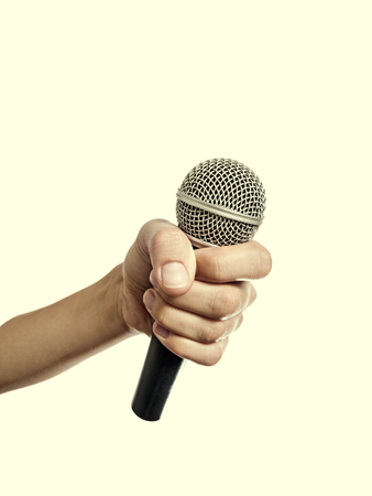 outstretched hand: Outstretched hand with a microphone