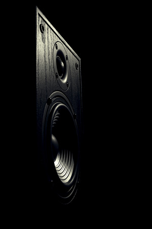 audiophile: black and white toned image of an audio speaker isolated on a black background Stock Photo