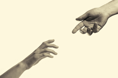 two hands reaching toward each other Stok Fotoğraf - 58726994