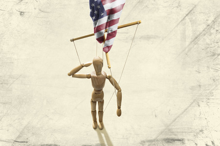 Hand painted in the colors of the American flag manipulates puppet on paper background