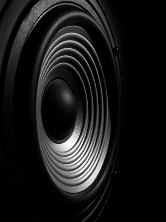 loud music: black and white image of a membrane sound speaker isolated on a black background