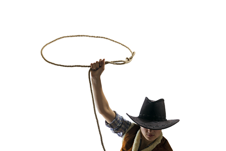 cowboy throws a lasso on the isolated background Reklamní fotografie