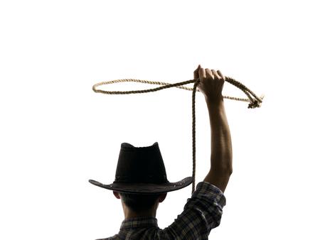 cowboy werpt een lasso op de geïsoleerde achtergrond Stockfoto