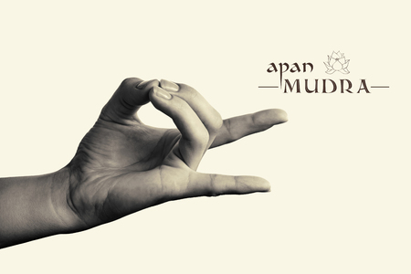 gyan: BW image of woman hand in apan mudra. Gesture is  isolated on toned background.
