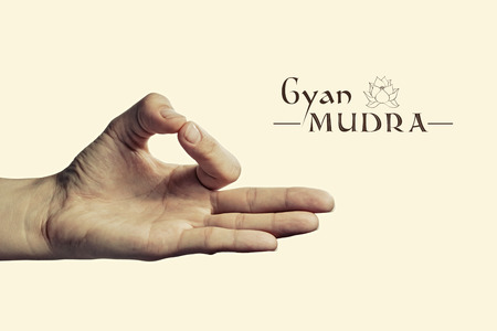 gyan: Image of woman hand in gyan mudra. Gesture is  isolated on toned background.