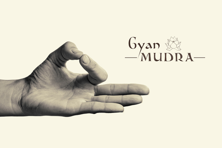 gyan: BW image of woman hand in gyan mudra. Gesture is  isolated on toned background.