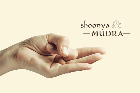 mudra: Image of woman hand in Shoonya mudra. Gesture is  isolated on toned background. Stock Photo