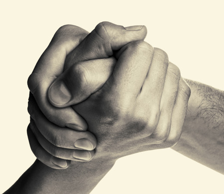 rivals: Struggle between the two rivals (arm wrestling). Image is black and white, toned, isolated. Stock Photo