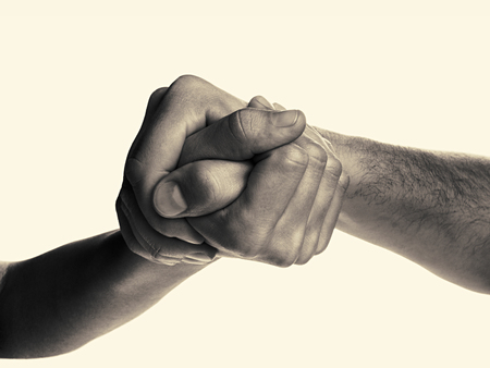 struggle: Struggle between the two rivals (arm wrestling). Image is black and white, toned, isolated. Stock Photo