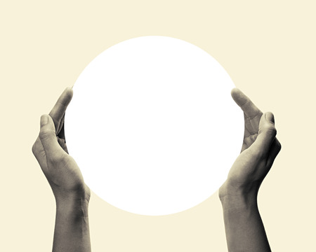 porting: Two hands holding a white, round object. This toned, black and white image is isolated on light  background  for ease of porting to your design. Stock Photo