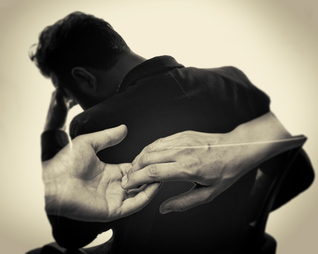 Concept, depicting parting. Black and white image created using multiple exposures. The photo silhouette upset man and a gesture symbolizing the parting.
