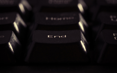 completion: Image of key end closeup. Exit concept, completion of something Stock Photo