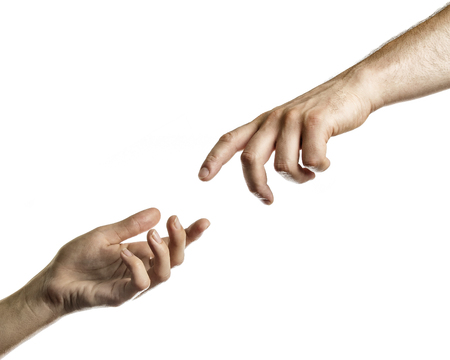 Two hands reach for each other. Image on white, isolated background. Stock Photo