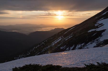 Mountain landscape at dawn with reflections of light in the snow. Stock Photo