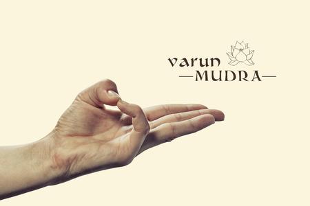 samadhi: Varun mudra. Yogic hand gesture. Isolated on toned background.