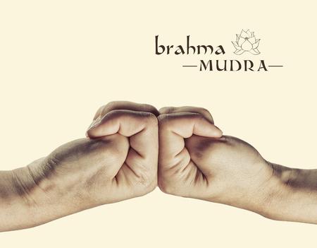 samadhi: Brahma mudra. Yogic hand gesture. Isolated on toned background. Stock Photo