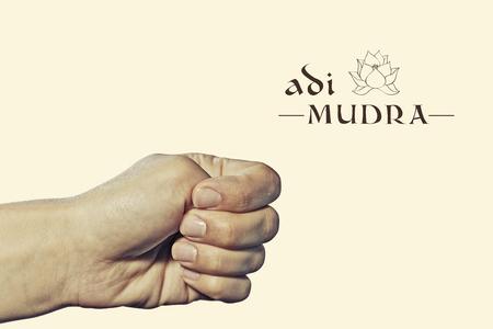 Adi mudra. Yogic hand gesture. Isolated on toned background.