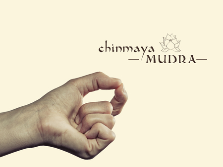 Chinmaya mudra. Yogic hand gesture. Isolated on toned background.