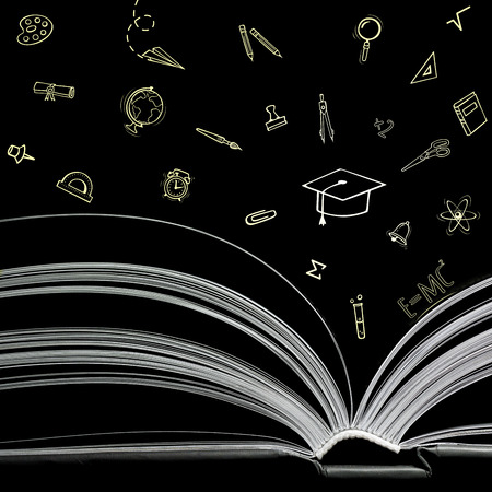 A black and white image of open book on black background. Close-up image of  double-page spread with icon school supplies and education icons. Concept of gaining knowledge, education Stock Photo