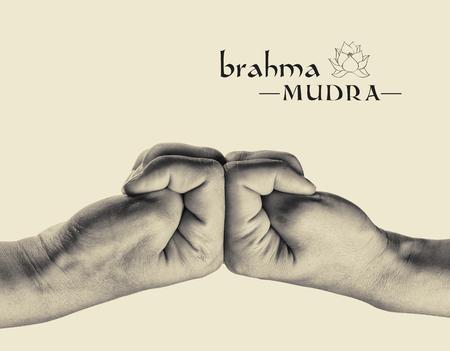 Brahma mudra. Yogic hand gesture. Isolated on toned background, black and white. Stock Photo